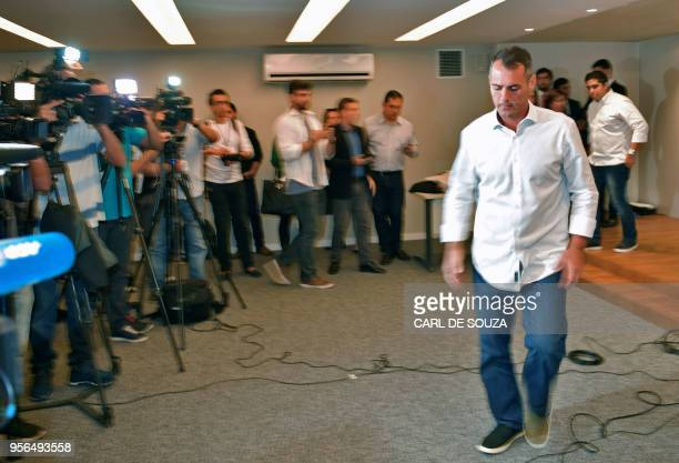 Councilor Marcello Siciliano leaves after delivering a press conference in Rio de Janeiro Brazil on May 9 2018 Siciliano has been accused by an...