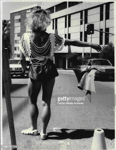 Councils Stop Go girls at Edgecliff directing traffic around road works Bhajan 'BJ' Rear view Marianne Butler March 13 1985