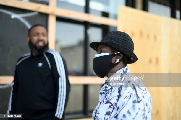 Councilwoman Cherelle Parker talks to store manager Mario Lawrence at a vandalized and looted Villa sneaker store in the Mt Airy/Wadsworth sections...
