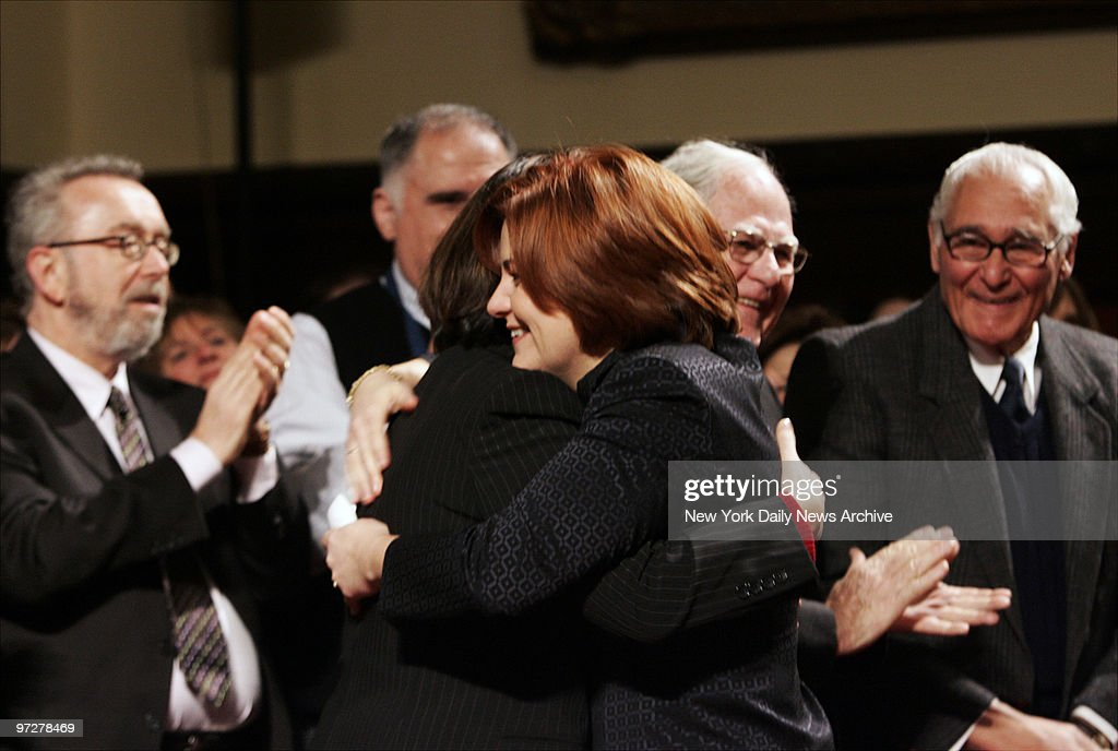 Councilwoman Christine Quinn hugs her partner, Kim Catullo, before being elected to be the first woman and first openly gay person to head the City Council.