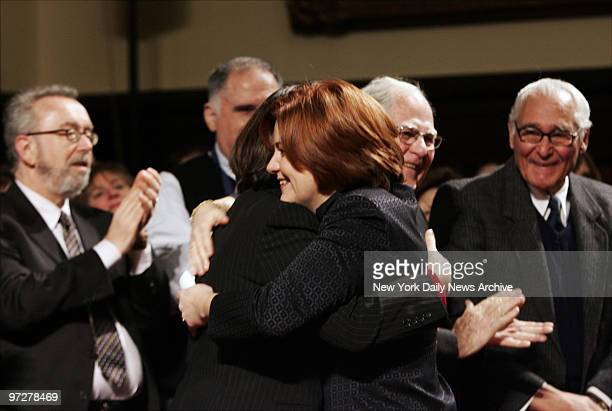 Councilwoman Christine Quinn hugs her partner Kim Catullo before being elected to be the first woman and first openly gay person to head the City...