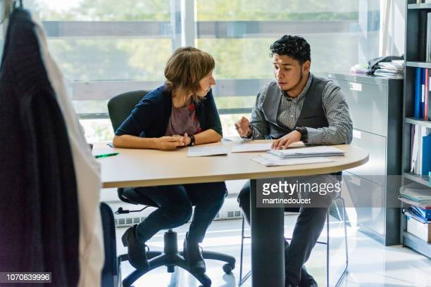 """counselling appointment for college student. - """"martine doucet"""" or martinedoucet stock pictures, royalty-free photos & images"""