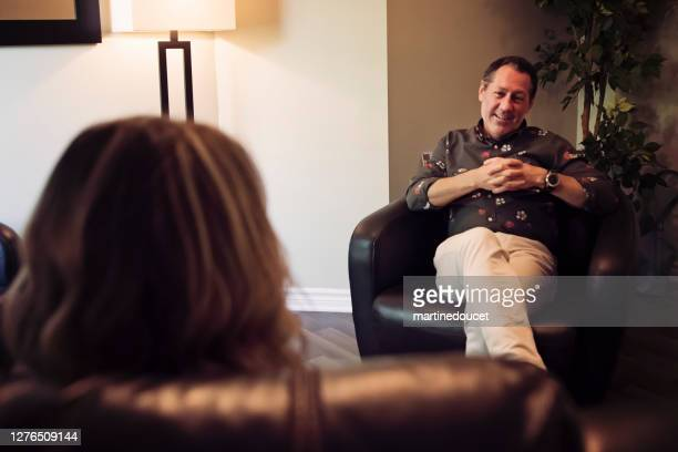 """counselling therapist sitting with client in office. - """"martine doucet"""" or martinedoucet stock pictures, royalty-free photos & images"""