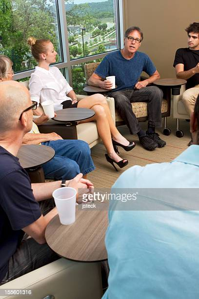 Counselor Assisting With Group Therapy