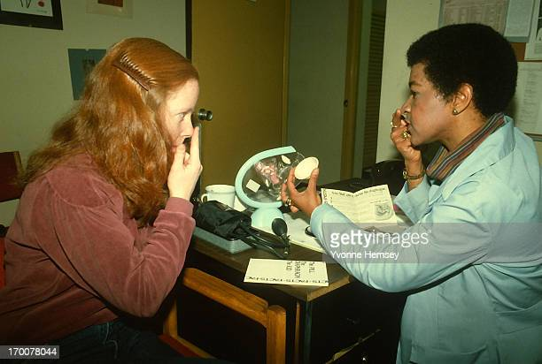 A counselor at a Planned Parenthood in New York City advices a young woman February 3 1988 on the proper way to insert a diaphragm The counseling...
