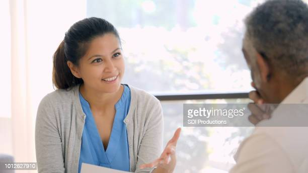 counselor encourages new patient - east asian ethnicity stock pictures, royalty-free photos & images