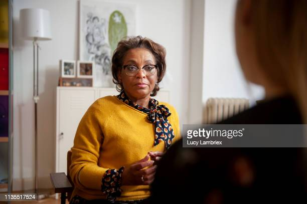 counselor listening to a young female client - mental health professional stock pictures, royalty-free photos & images