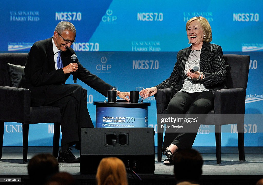Counselor to President Barack Obama John Podesta (L) and former Secretary of State Hillary Clinton attend the National Clean Energy Summit 7.0 at the Mandalay Bay Convention Center on September 4, 2014 in Las Vegas, Nevada.