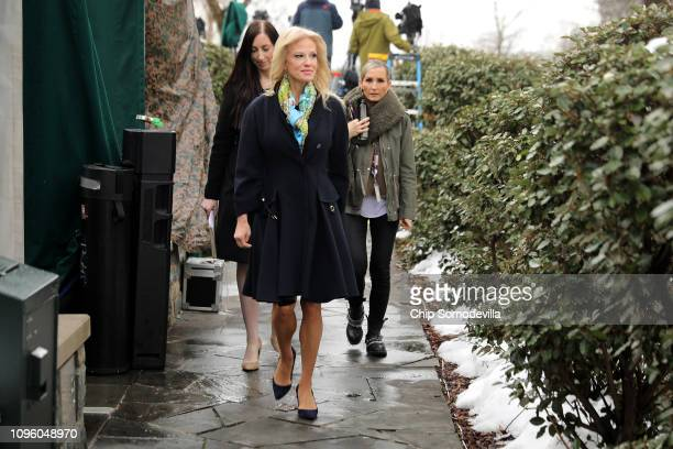 Counselor to the President Kelleyanne Conway walks out of the West Wing before a television interview with FOX News at the White House January 18...