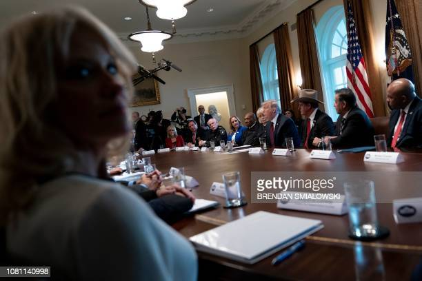 Counselor to the President Kellyanne Conway and others listen to US President Donald Trump during a meeting on border security in the Cabinet Room of...