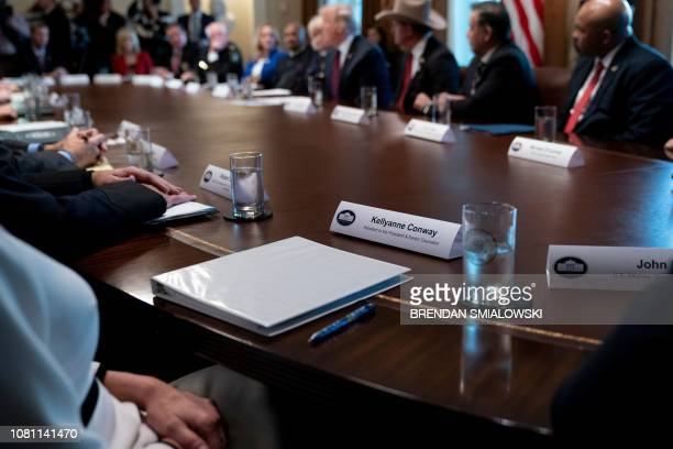 Counselor to the President Kellyanne Conway and others listen to US President Donald Trump during a meeting about border security in the Cabinet Room...