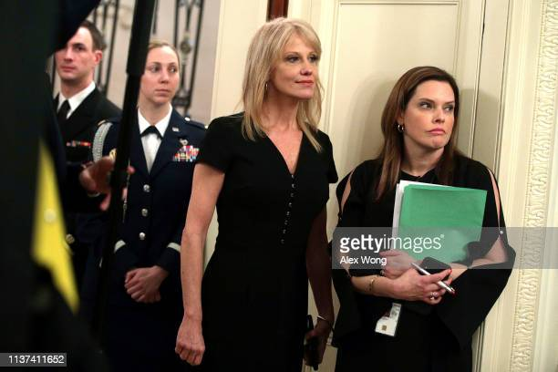 Counselor to the President Kellyanne Conway listens to US President Donald Trump during an East Room event at the White House March 21 2019 in...