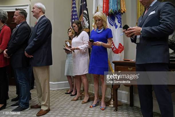 Counselor to the President Kellyanne Conway looks at her phone along with White House Director of Strategic Communications Mercedes Schlapp and Press...