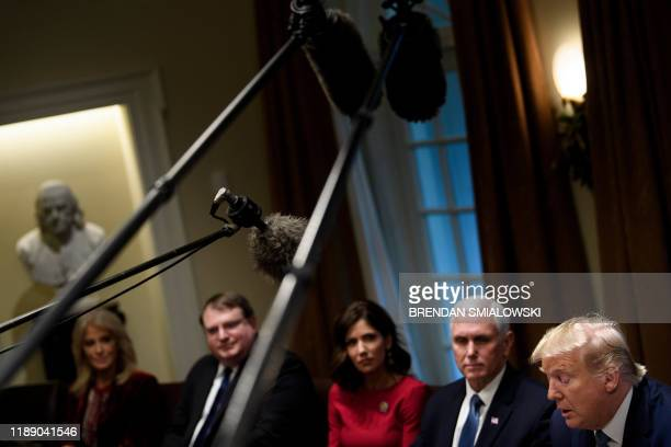 Counselor to the President Kellyanne Conway South Dakota's governor Kristi Noem US Vice President Mike Pence and others listen while US President...