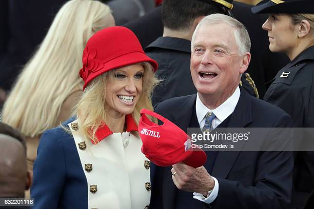 Counselor to the President Kellyanne Conway talks with former president Dan Quayle on the West Front of the US Capitol on January 20 2017 in...