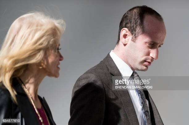 Counselor to US President Trump Kellyanne Conway and advisor Stephen Miller walk through the colonnade of the White House February 10 2017 in...