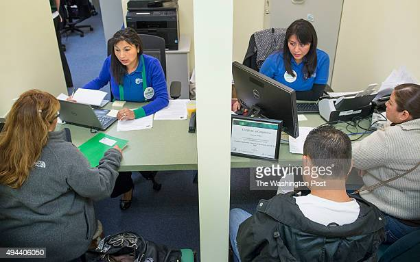 Counselors Amelia Kupchyk and Vanessa Gomez help clients with computer work required to navigate the second round of open enrollment for the...