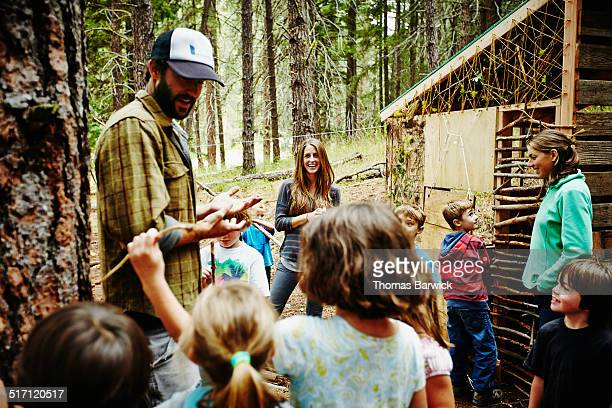 counselors giving instructions to kids at camp - leanintogether stock pictures, royalty-free photos & images
