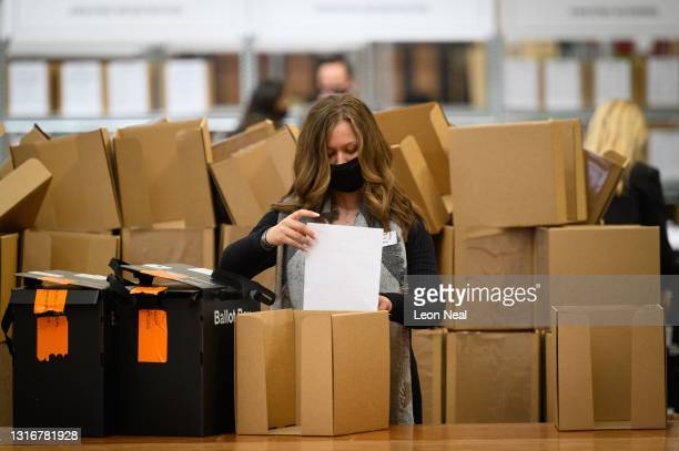 Count centre staff begin processing votes at Alexandra Palace on May 07, 2021 in London, England. The London Mayoral and Assembly election took place...