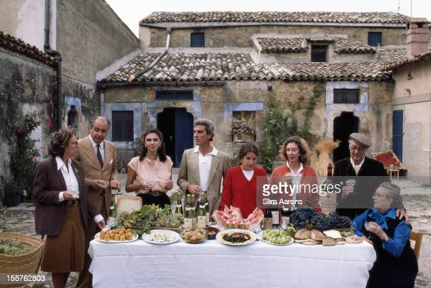 Count Giuseppe d'Almerita dining with guests in Sicily Italy in October 1984