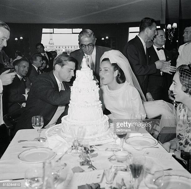 Count Hubert D'Ornano feeds a piece of wedding cake to his lovely bride the former Isabelle Potocka at their reception here as ship owner Aristotle...