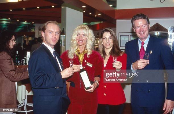 Count Maximilian von Bismarck and Gunilla with his product the Bismarck Korn schnaps at Ohe near Hamburg Germany 1990