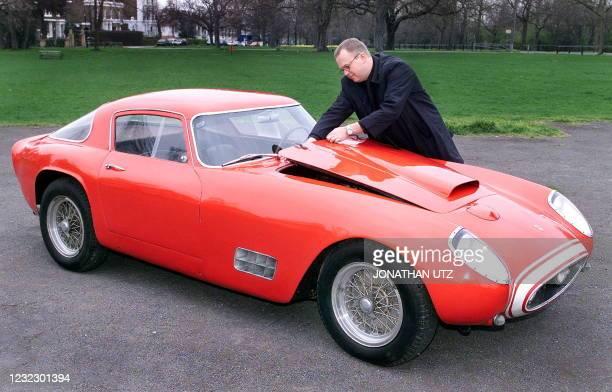Count Michael Ahlefeldt-Laurvig-Bille of Denmark raises 16 March 2000 in London the bonnet of his vintage 1956 Ferrari 250GT 'Tour de France'...