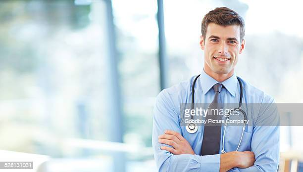 count on me for all your health needs - handsome doctors stock pictures, royalty-free photos & images