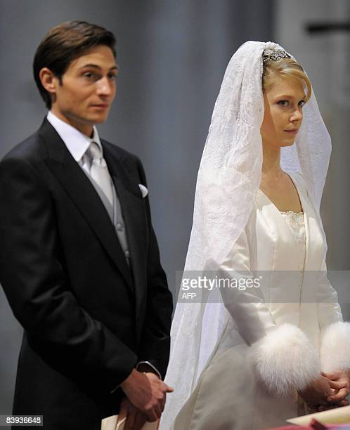 Count Rodolphe of Limburg Stirum and Archduchess Marie Christine of Austria stand during their wedding at the 'SintRomboutskathedraal' before her...