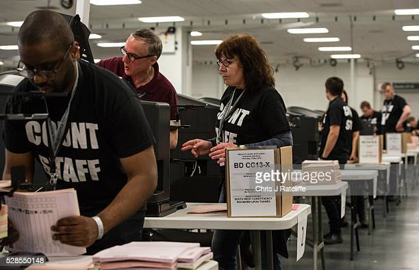 Count staff members put Richmond Upon Thames ballot papers the constituency of Conservative Mayoral condidate Zac Goldsmith through counting machines...