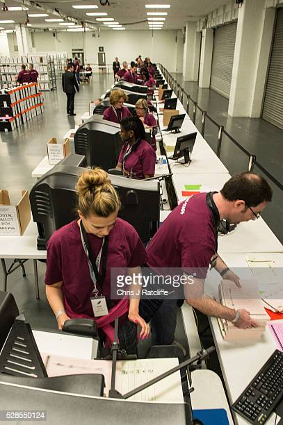Count staff use counting machines during the London Mayoral and Assembly election count at Kensington Olympia on May 6 2016 in London England This is...