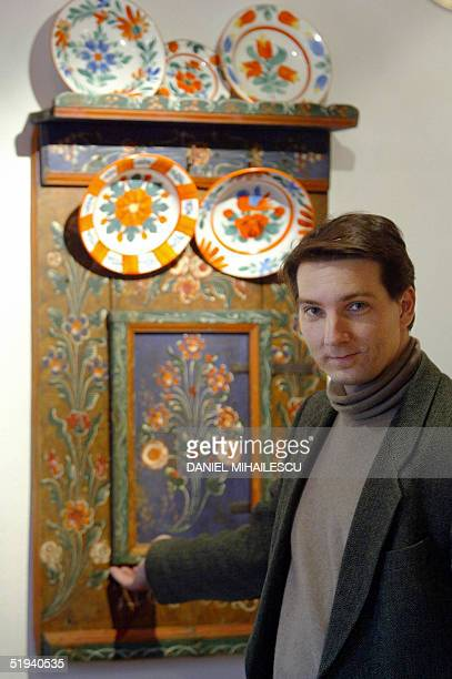 Count Tibor Kalnoky shows a guest room decorated with traditional hungarian artefacts at his manor in Miklosvar located in the heart of Transylvania...