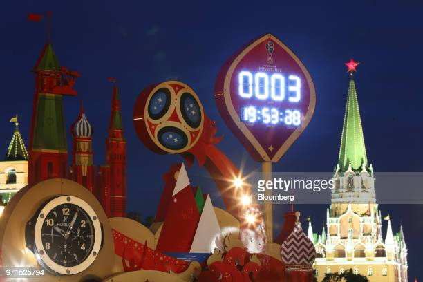 A countdown clock indicates the time left until the Russia World Cup tournament begins at a fan zone on Red Square in central Moscow Russia on Sunday...