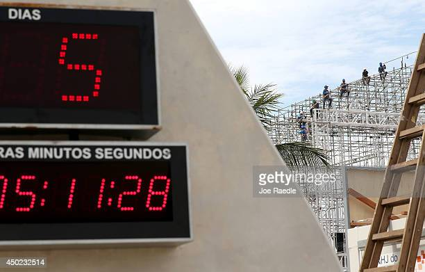 A countdown clock shows that there are 5 days to go before the start of World Cup soccer as workers continue to prepare the FIFA Fan Fest stage where...
