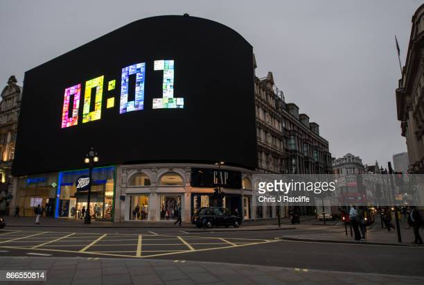 A countdown is seen on a large screen as the Piccadilly Circus lights are switched back on after a nine month renovation on October 26 2017 in London...
