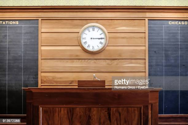 counter against wall clock - courtroom stock pictures, royalty-free photos & images