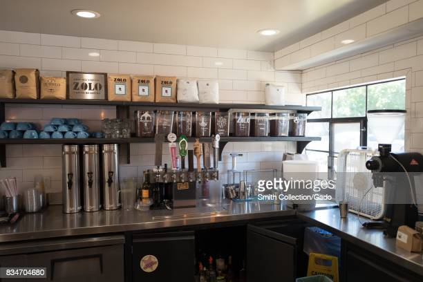Counter area of an artisan coffee shop in the San Francisco Bay Area town of Lafayette California with labeled containers holding coffee from...