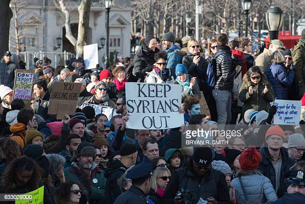 A counter demonstrator holds a sign up as protesters gather in Battery Park and march to the offices of Customs and Border Patrol in Manhattan to...