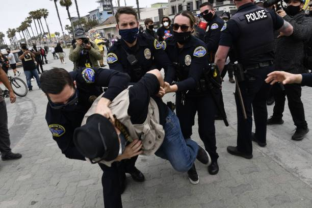 """CA: White Nationalists Group """"White Lives Matter"""" Organizes March In Huntington Beach"""