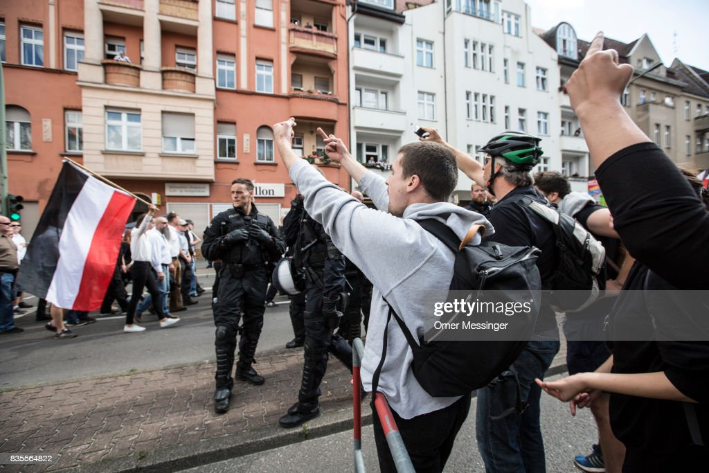 Counter demonstrators gesture towards participants affiliated with Neo-Nazi and extreme right groups at they marched through the street of Berlin's Spandau district in commemoration of 30 years to Rudolf Hess's death, on August 19, 2017 in Berlin, Germany. Hess committed suicide on August 17, 1987 at Spandau Prison and he also served as Adolf Hitler's deputy. The march attracted counter demonstrations along its route, organized by several left-wing groups and political parties.