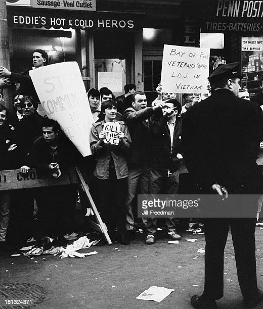Counter demonstrators supporting the Vietnam War line the route of the antiVietnam War 'Fifth Avenue Peace Parade' New York City 7th April 1967