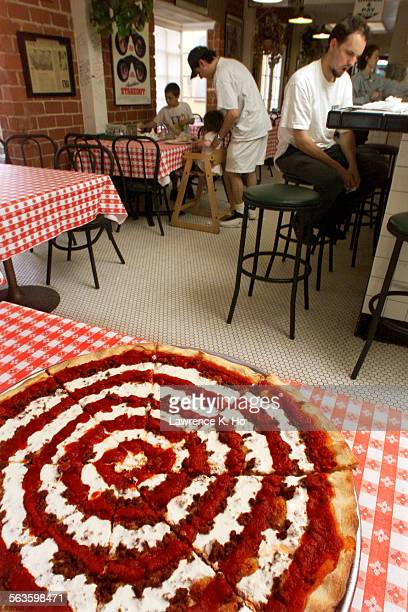Counter Intelligence on Mulberry Street Pizzeria in Beverly Hills Pic shows the lasagna pizza