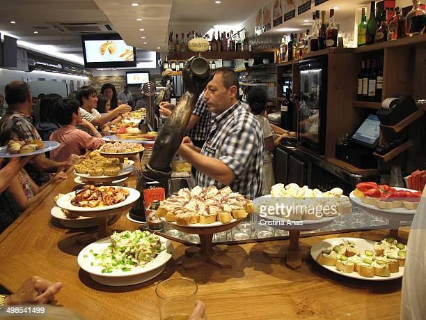 Counter of a bar with a variety of tapas and pinchos both traditional and more elaborate tapas are a small sample of the renowned Basque cuisine San...