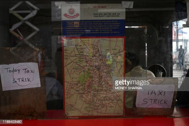 TOPSHOT A counter of taxi stand is closed as sheets announcing the strike are on display at Indira Gandhi International airport in New Delhi on...