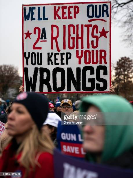 A counter protester holds up a sign supporting the Second Amendment as gun safety advocates rally in front of the US Supreme Court before during oral...