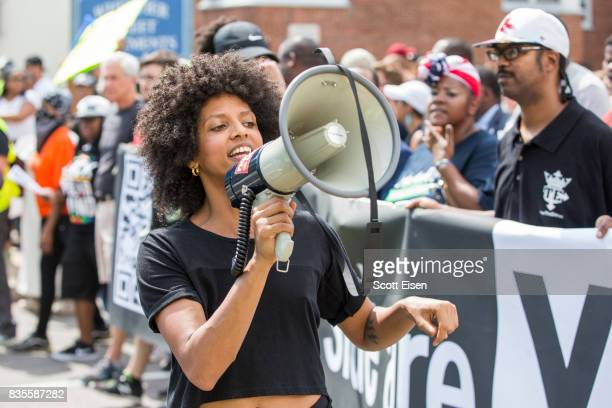 A counter protester talks into a megaphone during a march to the 'Free Speech Rally' on Boston Common on August 19 2017 in Boston Massachusetts...