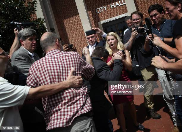 A counter protester tries to punch Jason Kessler an organizer of Unite the Right rally after Kessler tried to speak outside the Charlottesville City...