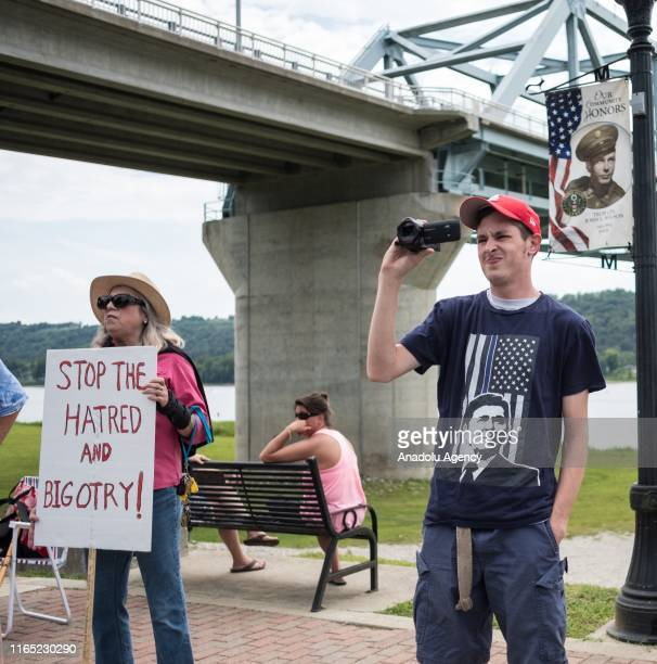 Counter protesters await the arrival of white supremacist racist organization Ku Klux Klan members during a rally in Madison Indiana United States on...