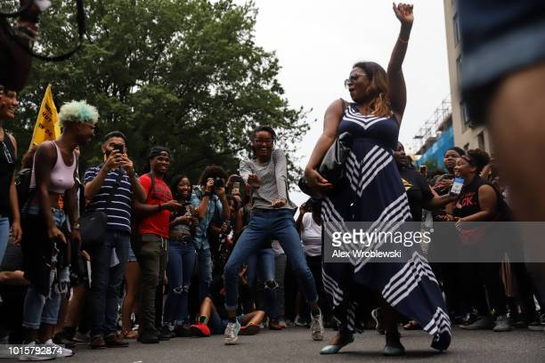 Counter protesters dance on H Street Northwest outside of Lafayette Park during the Unite the Right rally on August 12 2018 in Washington DC...