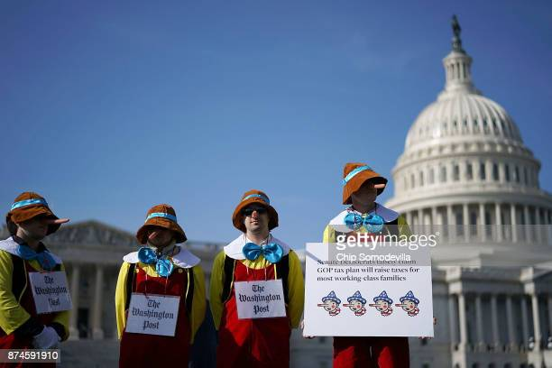 Counter protesters dress as Pinocchio while standing on the periphery of a rally against the proposed Republican tax reform legislation on the east...